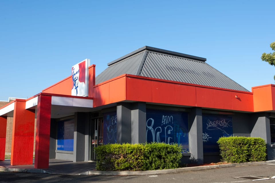 KFC store with commerical window shutters