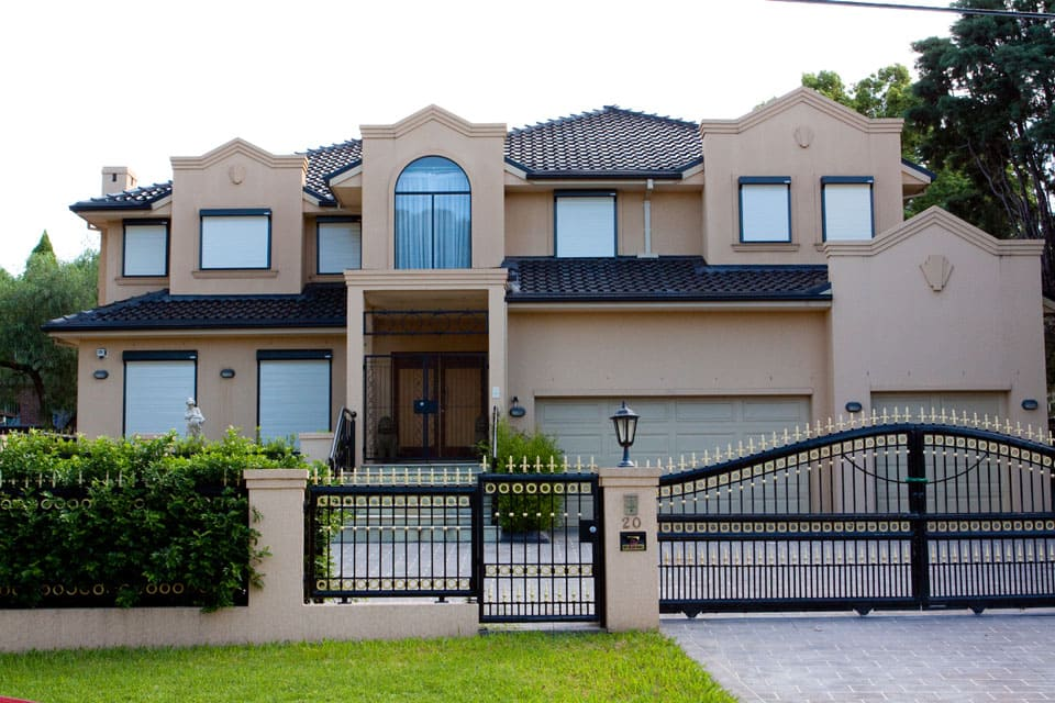 house with bulletproof window roller shutters front view